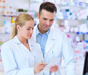 two pharmacists reading a prescription